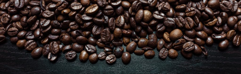Coffee beans on black wood