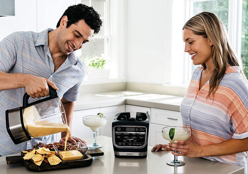 Couple using a Ninja cold and hot blender