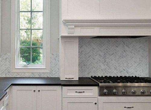 Diflart's Carrara Italian white herringbone marble mosaic tile