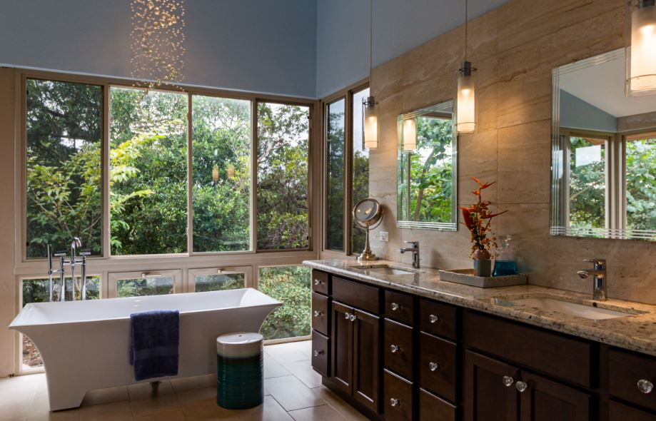 An eclectic bathroom with crystal knobs