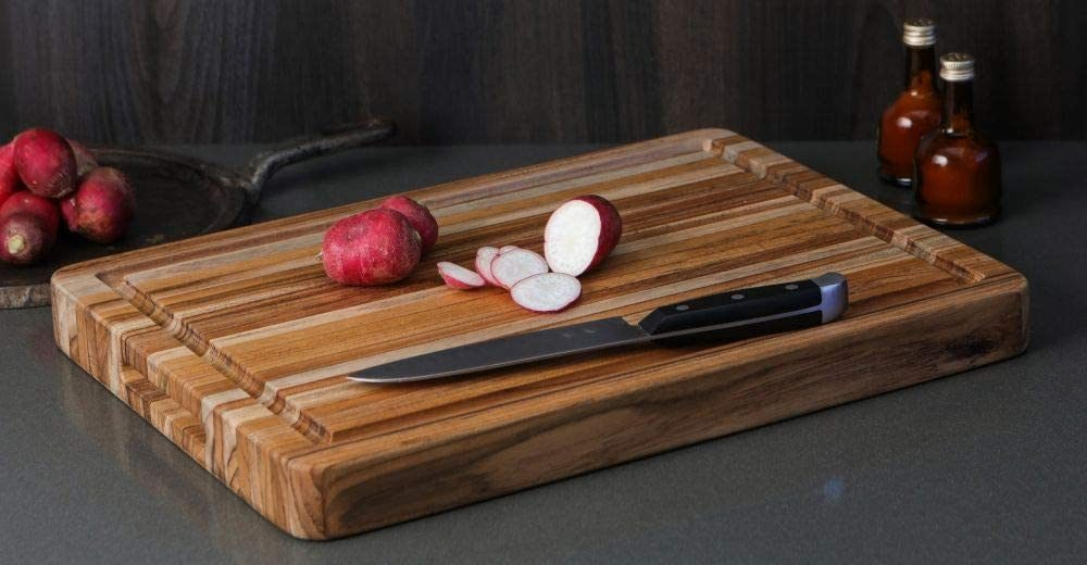 TeakHaus's Edge Grain Cutting Board with Hand Grip and Juice Canal