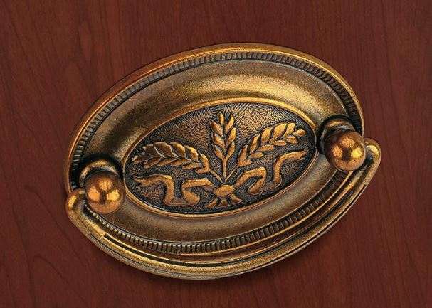 Tiica's antique brass-finished drop pulls