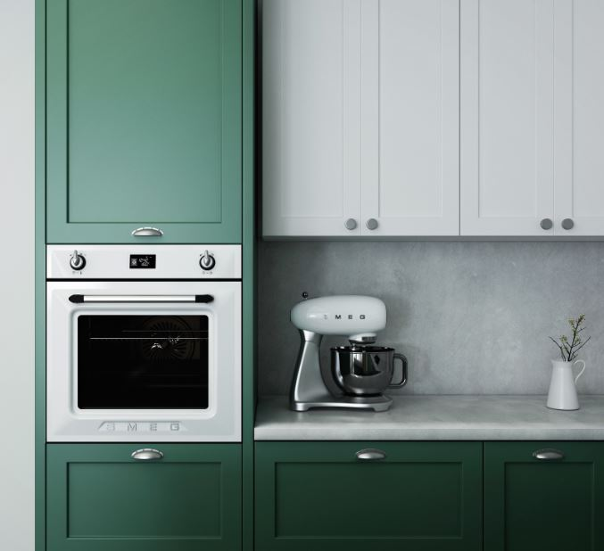 kitchen with cup pulls on the green cabinets and round knobs