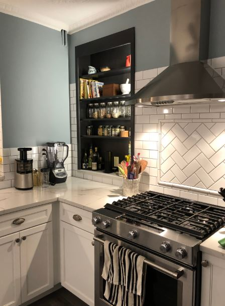 kitchen with cup pulls, round knobs, and white shaker cabinets