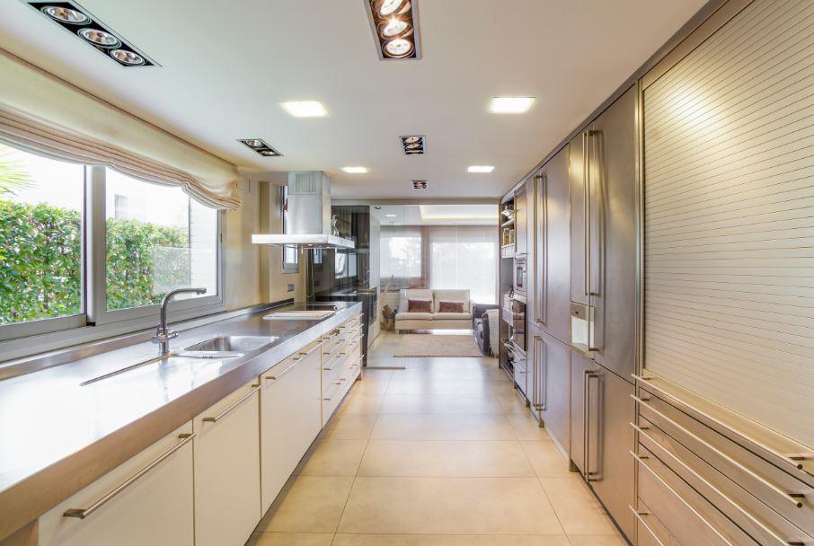 minimalist kitchen with slab cabinets