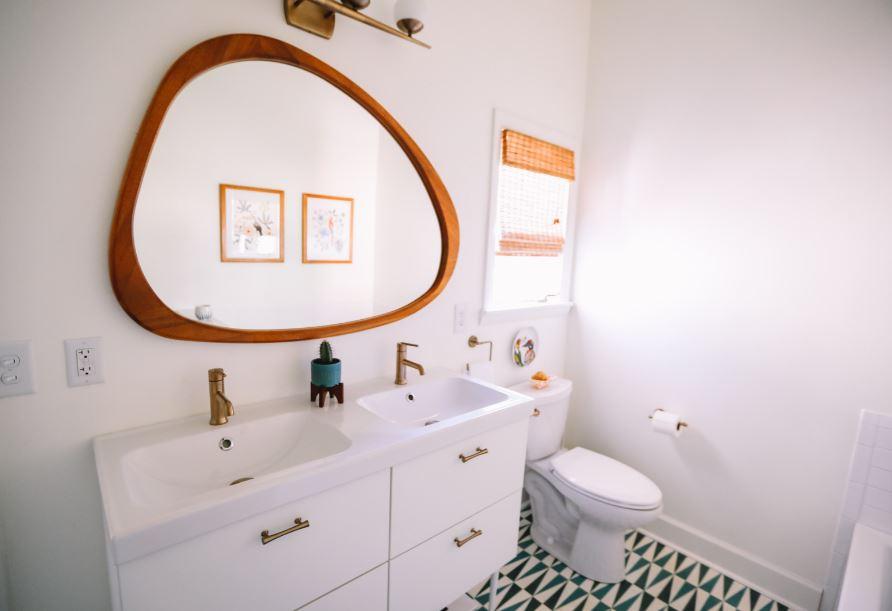 retro bathroom with a wooden, asymmetrical mirror
