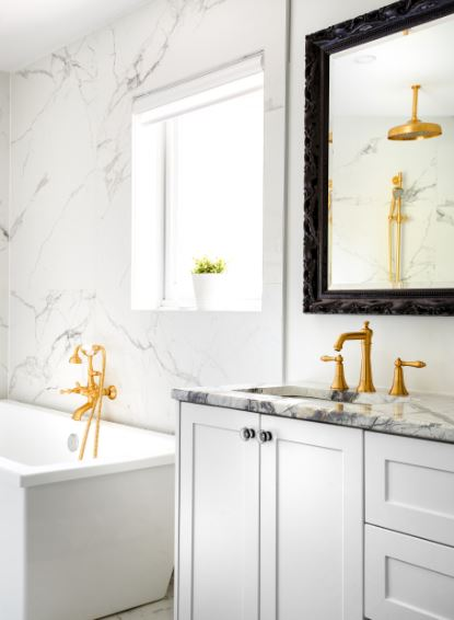 vintage style bathroom with gold tone fixtures